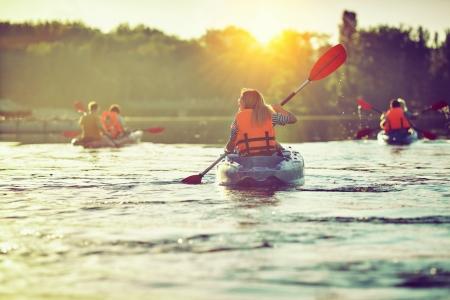 Teens kayaking in the summer